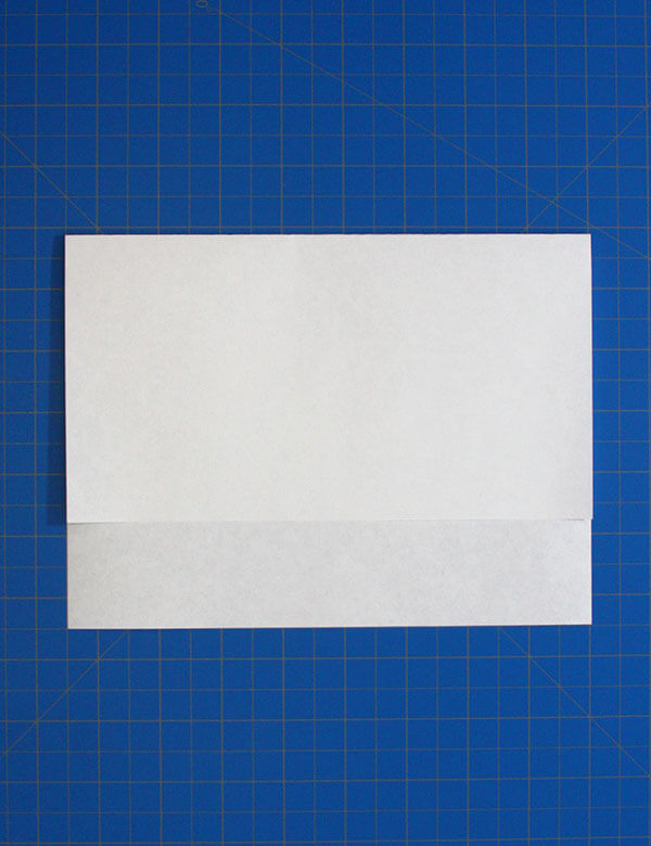 2 Fold The Top Two Corners To Center Line